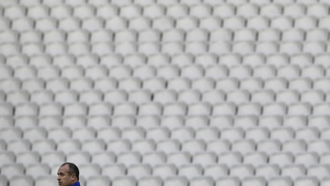 France's rugby team head coach Philippe Saint-Andre attends a training session at the Stade de France stadium, in Saint Denis, outside Paris, Friday, March 14, 2014. France will play Ireland during a Six Nations Rugby Union match on March 15. (AP Photo/Christophe Ena)