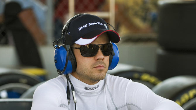 BMW Motorsports' Dirk Mueller, of Germany, sits in pit row during the 59th annual American Le Mans Series 12 Hours of Sebring auto race at the Sebring International Raceway Saturday, March 19, 2011 in Sebring, Fla. (AP Photo/Steve Nesius)