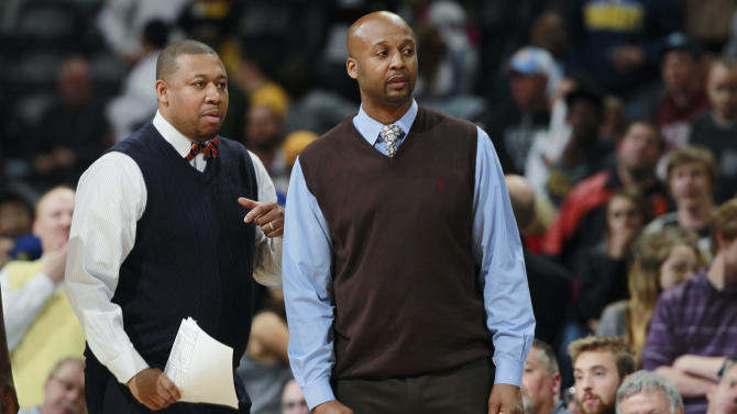 "FILE - In this April 16, 2014, file photo, Denver Nuggets assistant coach Melvin Hunt, left, joins head coach Brian Shaw in contesting a call while facing the Golden State Warriors in the fourth quarter of the Warriors' 116-112 victory in an NBA basketball game in Denver. The Nuggets have fired coach Brian Shaw after 1½ seasons. General manager Tim Connelly said in a statement Tuesday, March 3, 2015: ""You won't find a better guy than Brian and he is one of the brightest basketball minds I've ever been around. Unfortunately things didn't go as we hoped, but we know with his basketball acumen that he has a very bright future ahead of him."" Assistant coach Melvin Hunt will serve as interim coach. (AP Photo/David Zalubowski, File)"