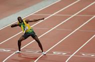 LONDON, ENGLAND - AUGUST 09: Usain Bolt of Jamaica celebrates after winning gold in the Men's 200m Final on Day 13 of the London 2012 Olympic Games at Olympic Stadium on August 9, 2012 in London, England. (Photo by Clive Brunskill/Getty Images)