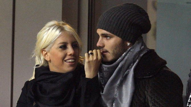 Inter Milan's Mauro Icardi looks on with his girlfriend Wanda Nara during their Italian Serie A soccer match against Chievo at San Siro stadium in Milan