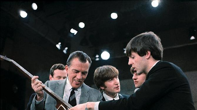 "FILE - In this Feb. 9, 1964. file photo Paul McCartney, right, shows his bass guitar to Ed Sullivan before the Beatles' live television appearance on ""The Ed Sullivan Show"" in New York along with John Lennon, center, and Ringo Starr, behind McCartney, and Beatles manage Brian Epstein, behind Sullivan. McCartney turned 70 Monday June 18, 2012. (AP Photo)"