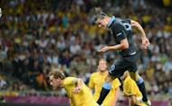 English forward Andy Carroll heads the ball to score during their Euro 2012 championships football match against Sweden at the Olympic Stadium in Kiev. A towering Carroll header midway through the opening period gave England a 1-0 lead over Sweden at half-time in Friday's crucial Euro 2012 Group D encounter in Kiev