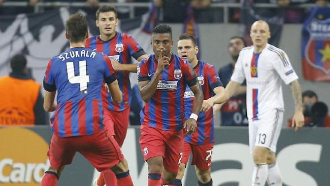 Steaua's Leandro Tatu, center, reacts after scoring against Basel during the UEFA Champions League group E soccer match between Steaua Bucharest and FC Basel, in Bucharest, Romania, on Tuesday, Oct. 22, 2013