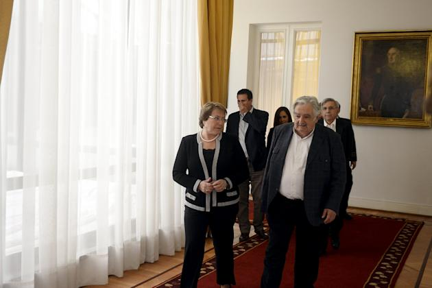 Handout photo of Chile's president Bachelet and Uruguay's former president Mujica meeting at the Presidential House in Santiago