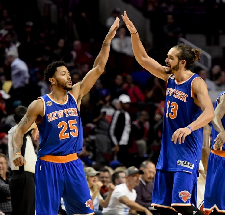 Derrick Rose and Joakim Noah celebrate another win at the United Center. (Associated Press)