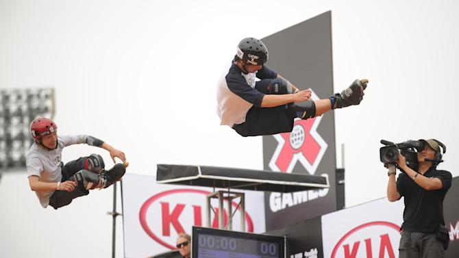Japanese skater Yuto Goto (R) and compatriot Soichiro Kanashima (L) compete in the Aggressive In-Line skating event  at the Kia X-Games Asia 2012 at the Jiangwan Sports Centre in Shanghai on April 30, 2012.  Soichiro Kanashima of Japan won the Aggressive In-Line skating event  ahead of Worapoj Boonnim of Thailand and Yuto Goto of Japan. AFP PHOTO/Peter PARKSPETER PARKS/AFP/GettyImages
