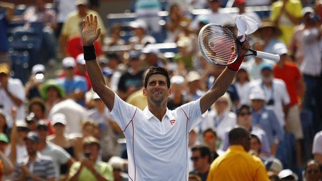 US Open - Djokovic shrugs off slow start to speed into third round