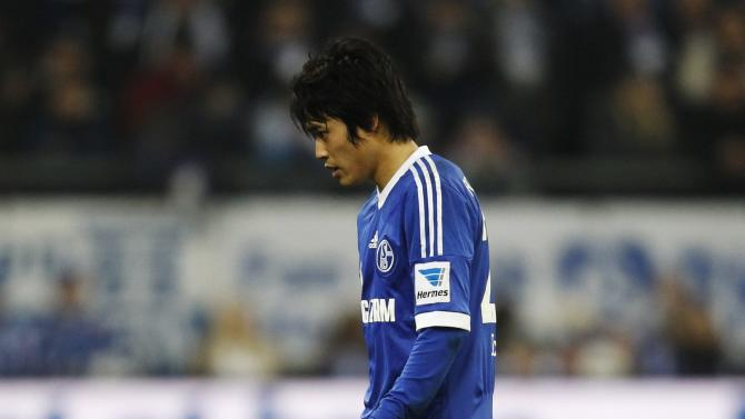 Schalke 04's Uchida leaves the field after sustaining an injury during the German first division Bundesliga soccer match against Hanover in Gelsenkirchen