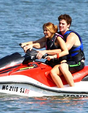 Bikini-Clad Miley Cyrus Jet Skis With On-Again Beau Liam Hemsworth