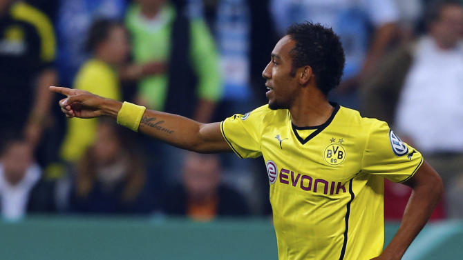 Dortmund's Aubameyang celebrates after he scored with a penalty during their second round German soccer cup match against TSV 1860 in Munich