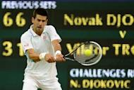 Serbia's Novak Djokovic plays a double-handed backhand shot during his fourth round men's singles victory over compatriot Viktor Troicki on day seven of the 2012 Wimbledon Championships at the All England Tennis Club in Wimbledon, southwest London, on July 2. The defending champion needed just 90 minutes to defeat Troicki 6-3, 6-1, 6-3
