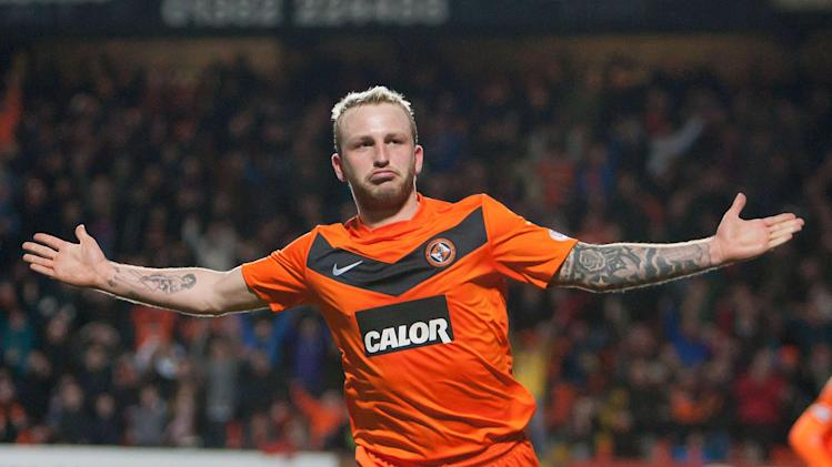 Johnny Russell kept his cool from the spot to earn victory for Dundee United