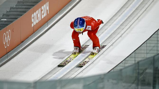 Germany's Kraus speeds down the ski jump during the men's ski jumping individual normal hill training event of the Sochi 2014 Winter Olympic Games in Rosa Khutor