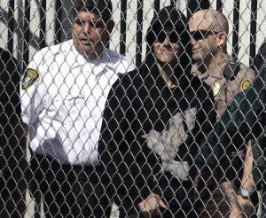Pop singer Justin Bieber is escorted out of the Turner Guilford Knight Correctional Center in Miami