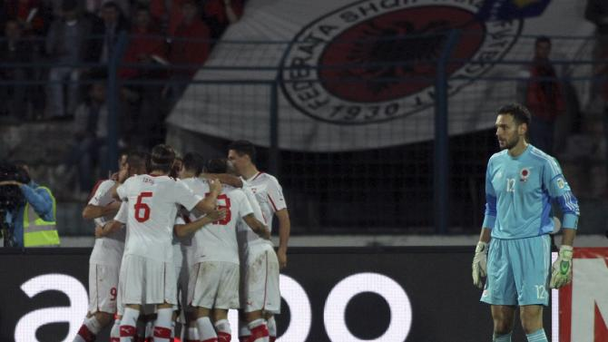 Switzerland's players celebrate after scoring against Albania during their 2014 World Cup qualifying soccer match in Tirana