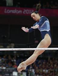 Britain's Beth Tweddle performs to win bronze during the women's uneven bars of the artistic gymnastics event of the London Olympic Games at the 02 North Greenwich Arena in London. Russia's gymnast Aliya Mustafina won gold and China's He Kexin took silver