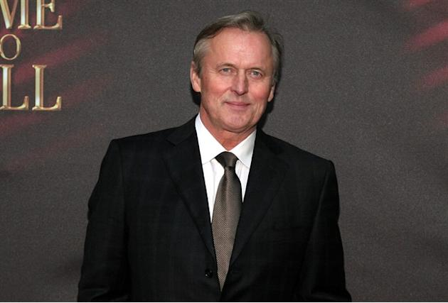 "FILE - This Oct. 20, 2013 file photo shows author John Grisham at the opening night of ""A Time To Kill"" on Broadway in New York. ReedPOP, the founder of New York Comic Con, announced Wednesd"