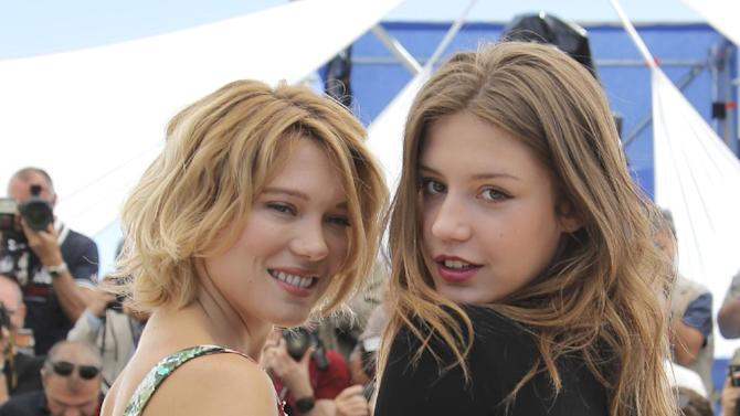 Actors Adele Exarchopoulos, left, and Lea Seydoux pose during a photo call for the film La Vie D'Adele at the 66th international film festival, in Cannes, southern France, Thursday, May 23, 2013. (AP Photo/Francois Mori)
