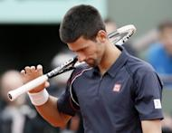 Serbia's Novak Djokovic looks tense during the French Open final against Rafael Nadal in Paris on June 11. Nadal clinched the title on Monday, defeating world number one Djokovic 6-4, 6-3, 2-6, 7-5 and shattering the Serb's dream of Grand Slam history