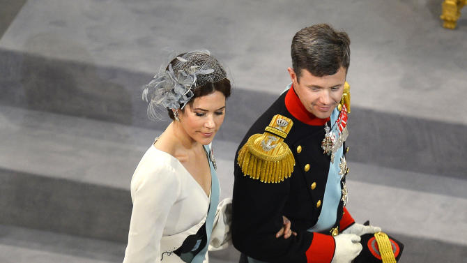 Denmark's Crown Prince Frederik and Crown Princess Mary walk past the crown inside the Nieuwe Kerk or New Church in Amsterdam, The Netherlands, during the inauguration of Dutch King Willem-Alexander Tuesday April 30, 2013. Around a million people are expected to descend on the Dutch capital for a huge street party to celebrate the first new Dutch monarch in 33 years. (AP Photo/Odd Andersen, Pool)