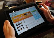A woman views the Chinese social media website Weibo at a cafe in Beijing in April 2012. Hong Kong researchers have developed software able to identify censored posts on China's main microblog Sina Weibo, they said Thursday