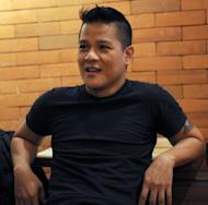 Humphrey Gorriceta gestures during an interview with AFP in Manila. Gorriceta, an HIV victim working with the government to spread awareness, says that it remained common in the gay community to engage in unprotected sex with multiple partners