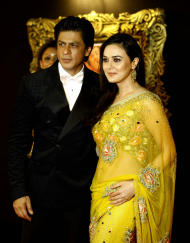 "In this Monday, Nov. 12, 2012 photo, Bollywood star Shah Rukh Khan, left, poses with fellow actor Preity Zinta during the premiere of his film ""Jab Tak Hai Jaan"" or ""As long as I Am Alive"" in Mumbai, India. Bollywood stars turned out in strength at the premiere of the movie for a final homage to movie mogul Yash Chopra, who died last month days after finishing the film. Chopra was known as the ""King of Romance"" for creating classic love stories that were immensely popular. (AP Photo/Rafiq Maqbool)"