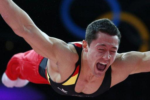 Germany's gymnast Marcel Nguyen competes on the rings during the men's qualification of the artistic gymnastics event of the London Olympic Games on July 28, 2012 at the 02 North Greenwich Are