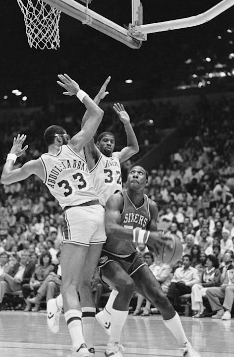 FILE - In this June 4, 1982, file photo, Philadelphia 76ers' Darryl Dawkins, right, tries rto get past the defense ofliterally is swamped by the defense of the Loa Angeles Lakers Kareem Abdul-Jabb