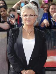 "FILE- This Thursday, July 7, 2011 file photo shows Julie Walters as she arrives in Trafalgar Square, central London, for the world premiere of ""Harry Potter and The Deathly Hallows: Part 2."" British television productions picked up a leading seven International Emmy nominations Monday, including an acting nod for Julie Walters in ""Mo."" (AP Photo/Jonathan Short, FILE)"