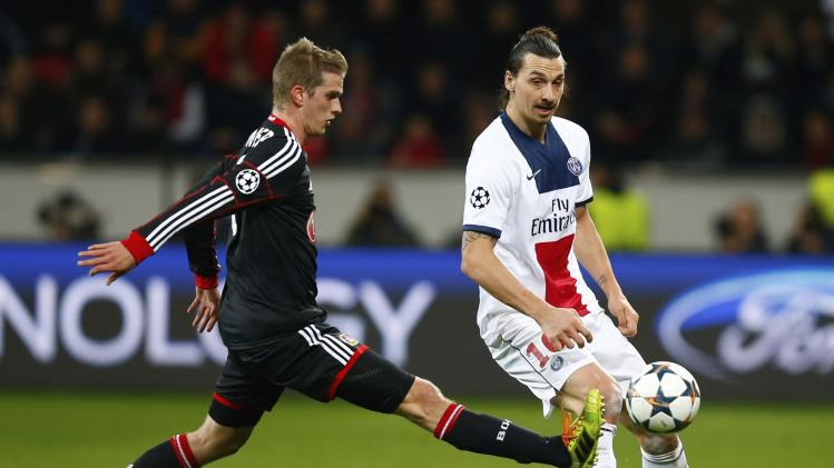 Bayer Leverkusen's Bender challenges Paris St Germain's Ibrahimovic during their Champions League soccer match in Leverkusen