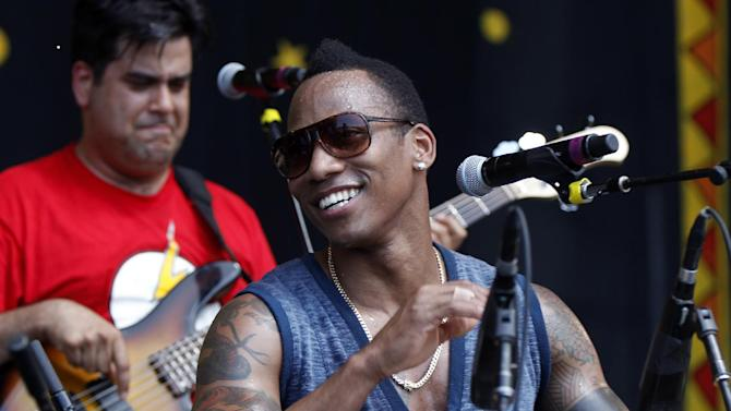 FILE - In this May 4, 2012 file photo, the Pedrito Martinez Group performs at the New Orleans Jazz and Heritage Festival in New Orleans. Martinez and the Red Baraat rhythms band are among the acts heading to New Orleans to headline a festival celebrating the music and culture rooted in Africa that made its way to the Caribbean and Gulf South region centuries ago. The Congo Square New World Rhythms Festival is a free event open to the general public. It is in its sixth year and will be held at Armstrong Park in New Orleans March 23, 2013 through March 24. (AP Photo/Gerald Herbert, File)