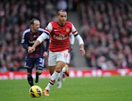 Arsenal striker Theo Walcott dribbles against Stoke City on February 2, 2013. Arsenal are set to become the first English Premier League club to play a friendly in Vietnam with a game in July during a pre-season tour of Asia