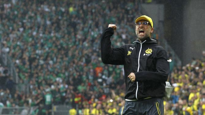 Borussia Dortmund's coach Klopp celebrates with his supporters after their team's first division Bundesliga soccer match against Werder Bremen in Dortmund