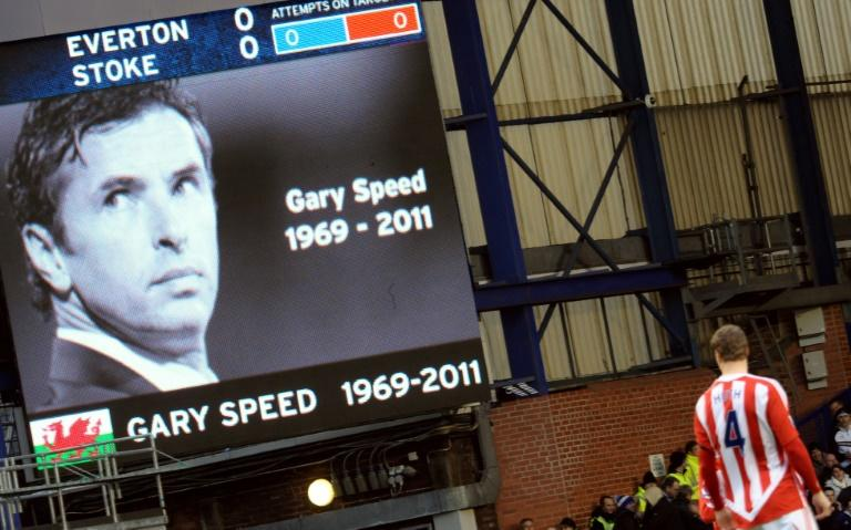 A tribute to Gary Speed is displayed on a screen before the match between Everton and Stoke City at Goodison Park in Liverpool, on December 4, 2011