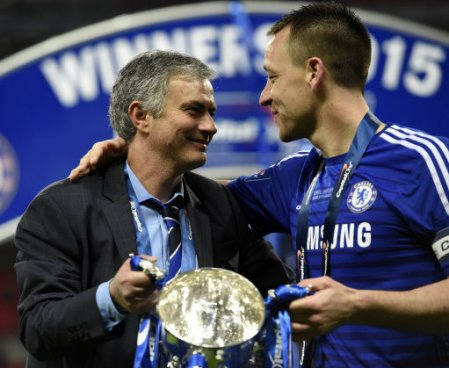 Chelsea manager Jose Mourinho celebrates his side winning the Capital One Cup with John Terry