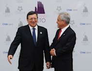 "European Commission President Jose Manuel Barroso (L) is welcomed by Chilean President Sebastian Pinera to the Latin American and Caribbean States-European Union Summit in Santiago, on January 26, 2013. Pinera, the summit host, hailed a ""new strategic alliance to promote growth, create jobs and improve the quality of life"" of citizens."