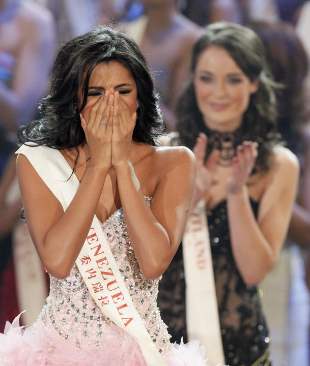 Miss Venezuela Ivian Sarcos reacts as she is announced winner at the Miss World competition held at Earls Court in London, Sunday, Nov. 6, 2011. (AP Photo/Kirsty Wigglesworth)