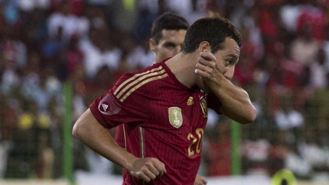 Spain's Santi Cazorla celebrates after scoring against Equatorial Guinea during a friendly soccer match at Malabo Stadium in Malabo, Equatorial Guinea, Saturday, Nov. 16, 2013