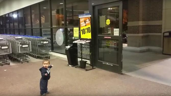 Watch baby mesmerized by grocery store s automatic sliding