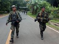 Philippine marines patrol a highway on Basilan island in 2010. Philippine forces clashed with Muslim extremists on a southern island Thursday, leaving seven soldiers and four militants dead, the military said
