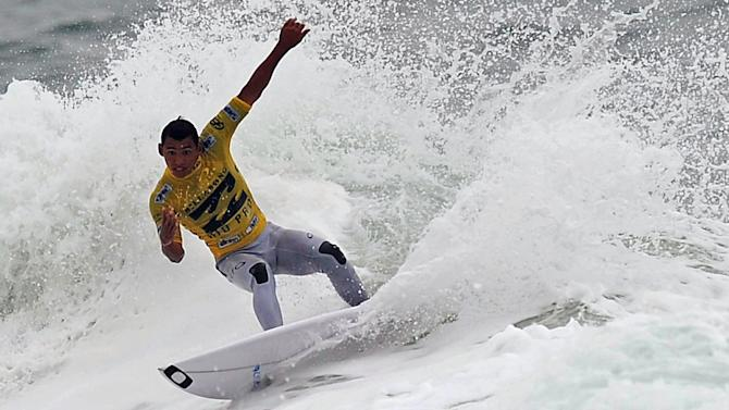Brazilian surfer Jadson Andre competes in the Association of Surfing Professionals' men's 2012 ASP World Championship Tour at Barra da Tijuca beach in Rio de Janeiro, Brazil, on May 14, 2012.  AFP PHOTO/VANDERLEI ALMEIDAVANDERLEI ALMEIDA/AFP/GettyImages