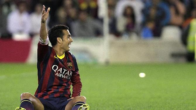 Barcelona's Pedro Rodriguez gestures during their La Liga soccer match against Betis at the Benito Villamarin stadium, in Seville, Spain, Sunday, Nov. 10, 2013