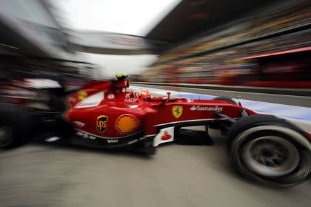 Ferrari Formula One driver Kimi Raikkonen of Finland drives out of the team garage during the second practice session of the Chinese F1 Grand Prix at the Shanghai International circuit