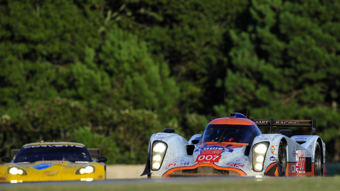 Lola Aston Martin driver Harold Primat (007), of Switzerland, goes through a corner during the American Le Mans Series' Petit Le Mans auto race at Road Atlanta, Saturday, Oct. 1, 2011, in Braselton, Ga. (AP Photo/Rainier Ehrhardt)