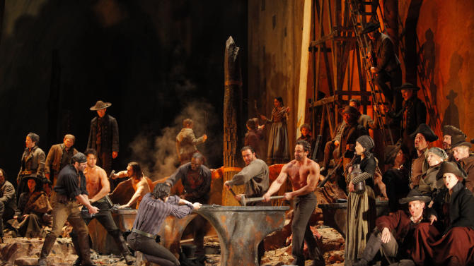 """This Feb. 13, 2009  production photo provided by the Metropolitan Opera shows a scene from Verdi's """"Il Trovatore"""" at the Metropolitan Opera in New York. The current revival of David McVicar's fast-moving, Goyaesque production, which starred soprano Angela Meade as Lenora on Wednesday, Jan 16, 2013, had already been seen during the season's opening week, but with an entirely different cast. The only holdover was conductor Daniele Callegari, who brought more energy and drive to the score than he had back in September. (AP Photo/Metropolitan Opera, Ken Howard)"""