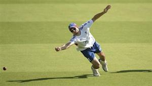 England's captain Alastair Cook dives to take a catch during a training session before Wednesday's fifth Ashes cricket test match against Australia at The Oval cricket ground, London August 20, 2013. REUTERS/Philip Brown