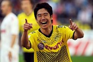 "Japan international Shinji Kagawa, pictured in March 2012, is set to become Manchester United's first summer signing after the Premier League club confirmed Tuesday they have ""reached agreement"" with his club Borussia Dortmund"