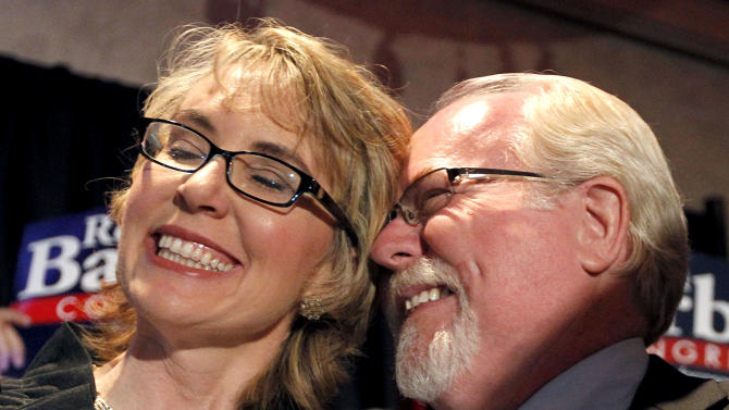 In an election to fill former Rep. Gabrielle Giffords, D-Ariz., congressional seat, Democratic candidate Ron Barber, right, celebrates a victory with Giffords, left, as he gives her a hug prior to speaking to supporters at a post election event, Tuesday, June 12, 2012, in Tucson, Ariz.  Gabrielle Giffords' former district director, in a special election for the seat Giffords left in January to focus on her recovery from a gunshot wound to her head during a gunman's shooting spree a year earlier.(AP Photo/Ross D. Franklin, pool)